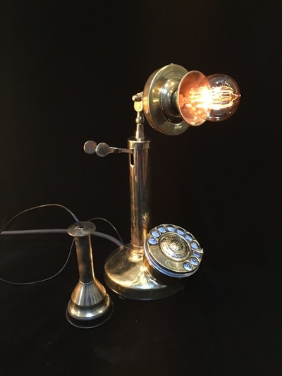 Vintage phone lamp featuring an Edison bulb. Lift receiver to illuminate, turn dial for dimmer