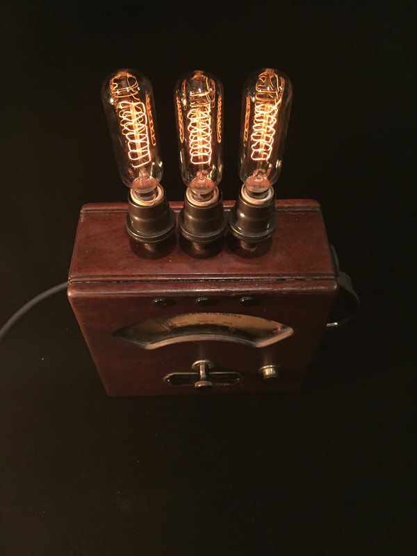 Volt meter lamp featuring Edison bulbs.  Measures current
